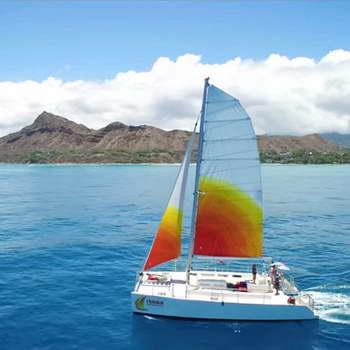 Holokai Catamaran sails past Diamond Head